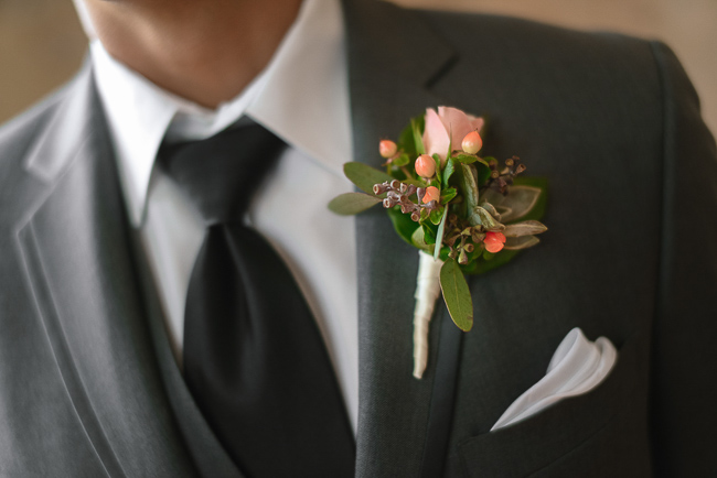 the groom's boutonniere | photo: Photos by Kristopher | via https://emmalinebride.com