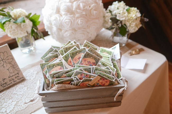 wildseed packets for guests to take home as favors | photo: Photos by Kristopher | via https://emmalinebride.com