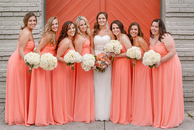 the bridesmaids wore pink strapless chiffon gowns | photo: Photos by Kristopher | via https://emmalinebride.com