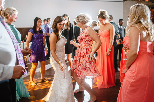 guests dance at the reception | photo: Photos by Kristopher | via https://emmalinebride.com