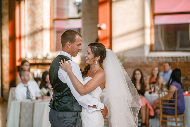 the bride and groom's first dance | photo: Photos by Kristopher | via https://emmalinebride.com