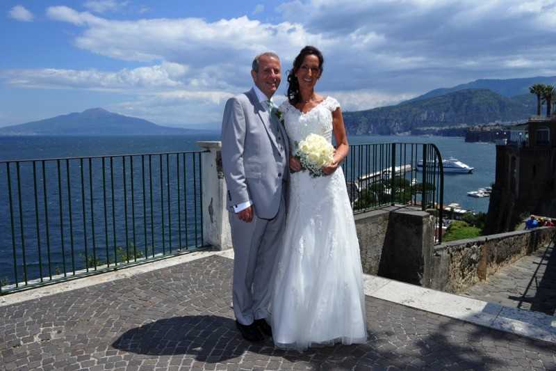 bride and groom stand in front of the Bay of Naples| Planner: Venice Events | via https://emmalinebride.com/real-weddings/italian-weddings-destination/