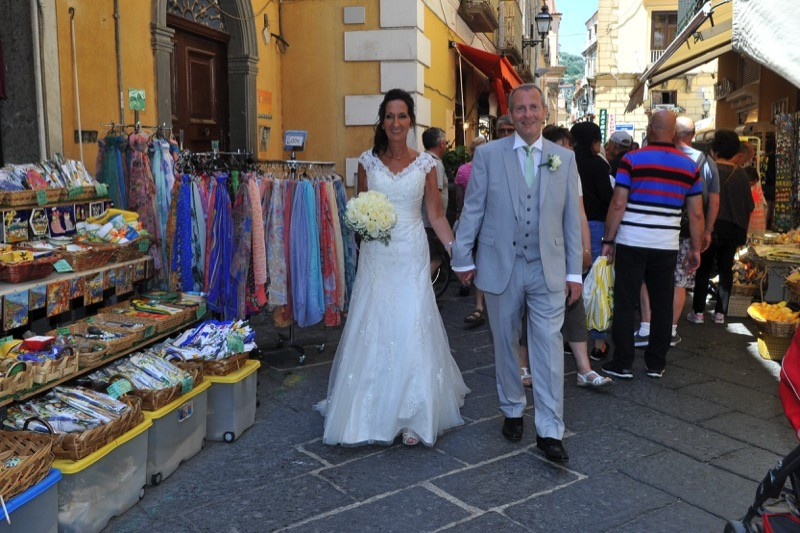 bride and groom walking the streets of Sorrento, Italy| Planner: Venice Events | via https://emmalinebride.com/real-weddings/italian-weddings-destination/