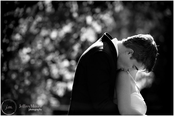 bride groom kiss on shoulder