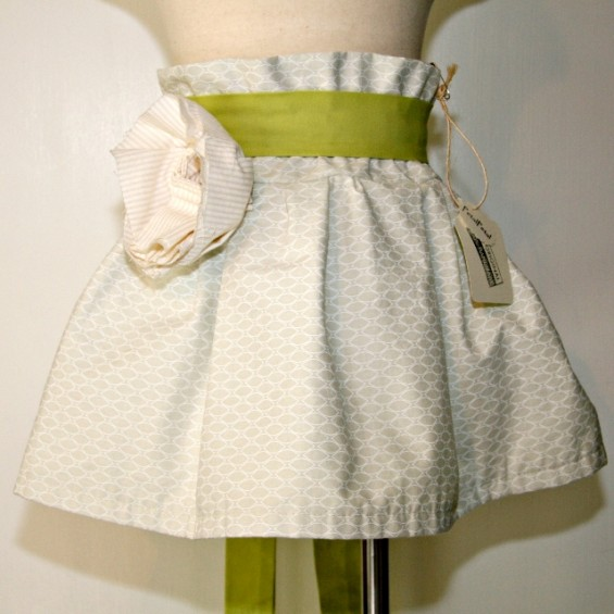 green flower girl skirt with pattern and large rose