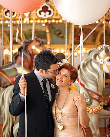 bride and groom on carousel