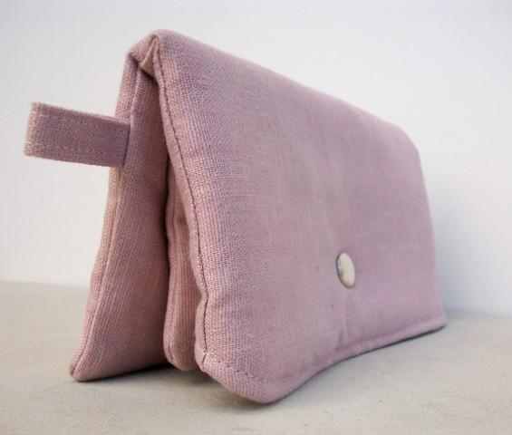 pink clutch purse side view