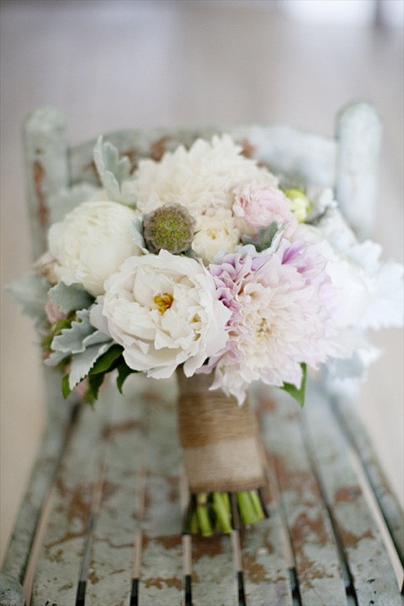 rustic wedding bouquet wrapped in burlap and jute twine