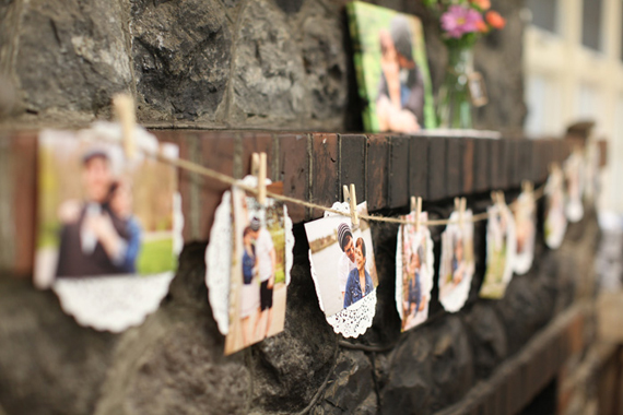 bridal shower photo display with clothespins and doilies