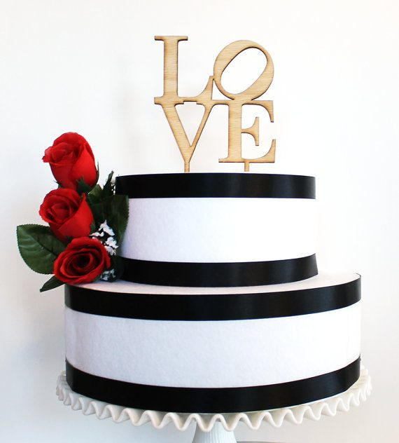 LOVE wood wedding cake topper by Tiffzippy | via Wood Themed Wedding Ideas: https://emmalinebride.com/themes/wood-themed-wedding-ideas/