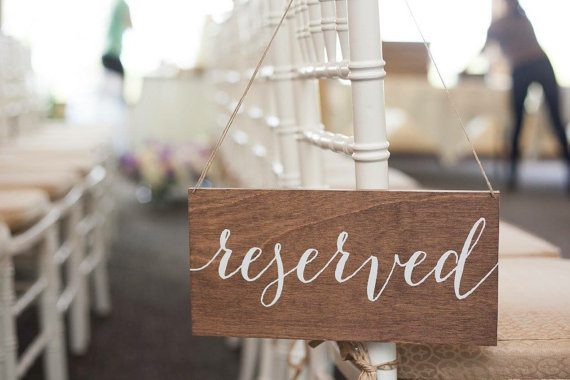 Reserved sign made of wood by Paper and Pine Co | via Wood Themed Wedding Ideas: http://emmalinebride.com/themes/wood-themed-wedding-ideas/