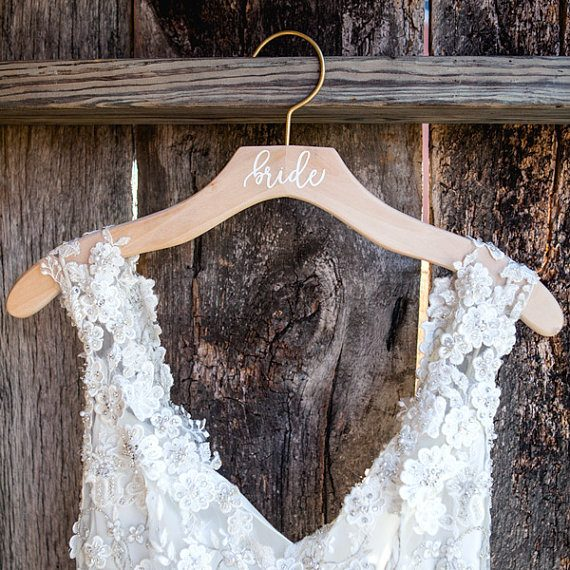 Bride wood dress hanger by Deighan Design | via Wood Themed Wedding Ideas: https://emmalinebride.com/themes/wood-themed-wedding-ideas/