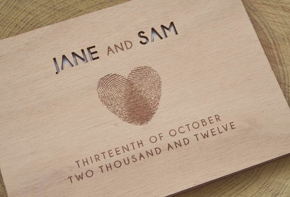 Wood guest book with fingerprints and personalized cover by Totally Salinda | via Wood Themed Wedding Ideas: http://emmalinebride.com/themes/wood-themed-wedding-ideas/