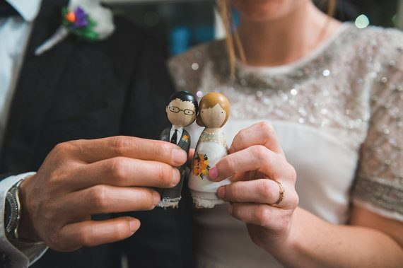 wood peg dolls by goosegrease | via Wood Themed Wedding Ideas: https://emmalinebride.com/themes/wood-themed-wedding-ideas/