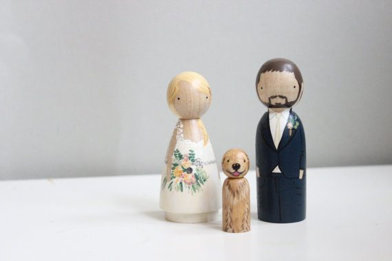 Wood peg doll cake topper by Goose Grease | via Wood Themed Wedding Ideas: https://emmalinebride.com/themes/wood-themed-wedding-ideas/