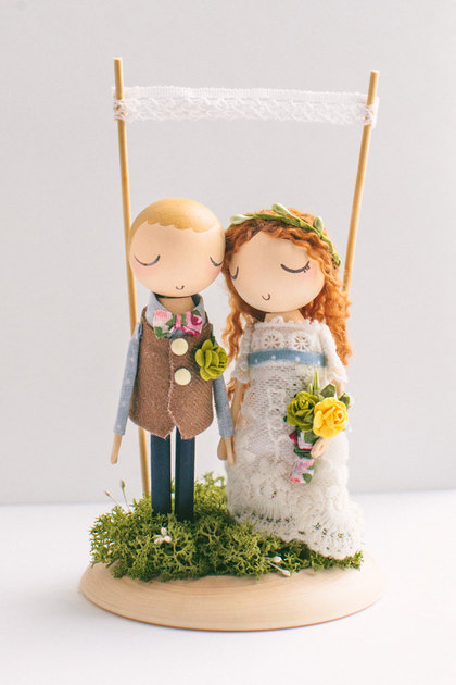 Wooden cake topper figurine by The Roomba | via Wood Themed Wedding Ideas: http://emmalinebride.com/themes/wood-themed-wedding-ideas/