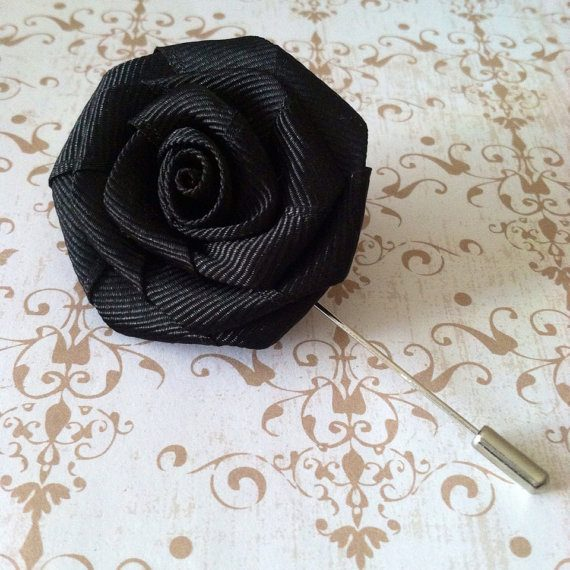 Black lapel piny via 30 Amazing Halloween Wedding Ideas from EmmalineBride.com