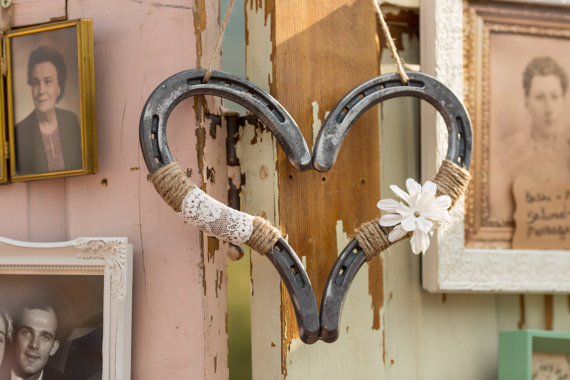 horseshoe heart decor by DownInTheBoondocks | barn reception ideas for weddings via https://emmalinebride.com/reception/barn-ideas-weddings/ ‎