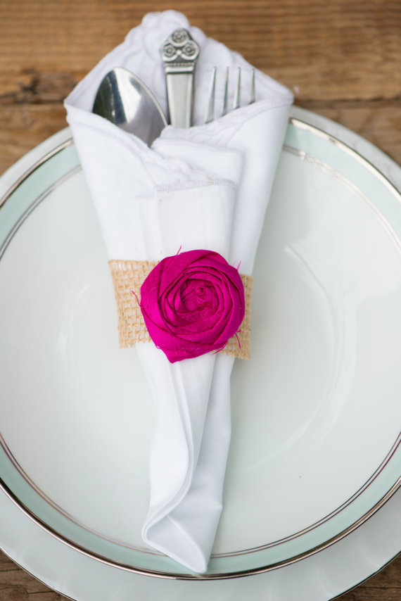napkin ring with burlap and flower by bellerosedesigns | Top 10 Burlap Ideas for Spring & Summer Weddings http://emmalinebride.com/rustic/burlap-ideas-weddings/