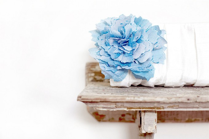 beautiful white clutch with blue flower | bridesmaid clutches instead of flowers via http://emmalinebride.com/bridesmaid/clutches-instead-of-flowers/