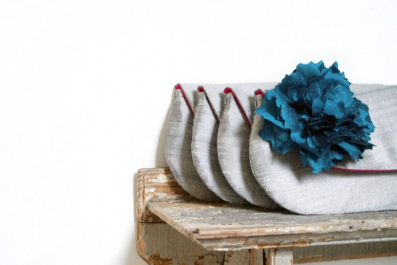 clutch purse with peacock blue flower | bridesmaid clutches instead of flowers via http://emmalinebride.com/bridesmaid/clutches-instead-of-flowers/