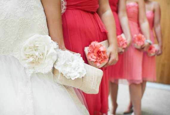 coral pink bridesmaid clutches | bridesmaid clutches instead of flowers via http://emmalinebride.com/bridesmaid/clutches-instead-of-flowers/