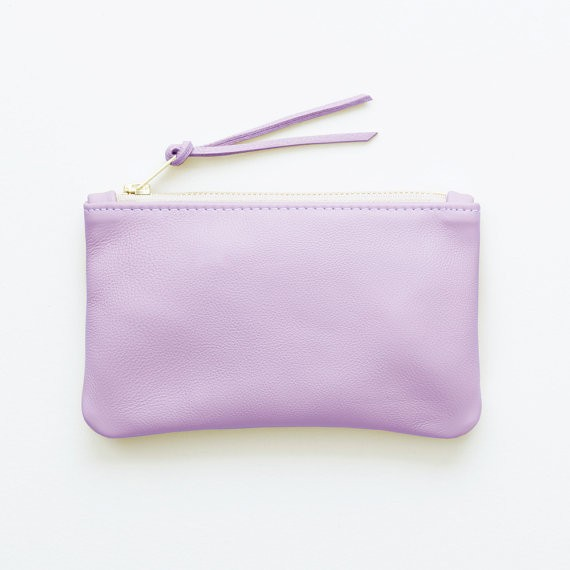 lavender leather clutch for bridesmaids instead of flowers