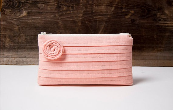 peach pink rosette bridesmaid clutch | bridesmaid clutches instead of flowers via https://emmalinebride.com/bridesmaid/clutches-instead-of-flowers/