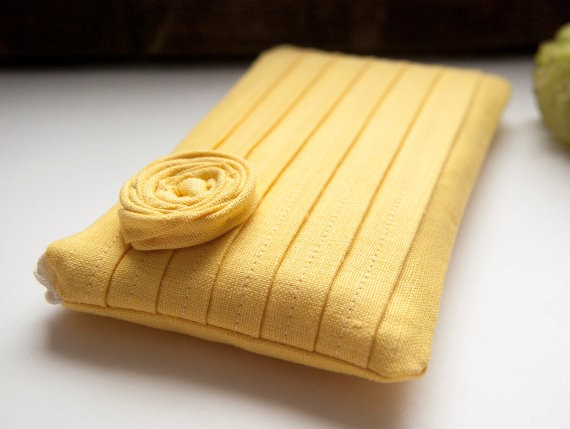 yellow rosette bridesmaid clutch | bridesmaid clutches instead of flowers via https://emmalinebride.com/bridesmaid/clutches-instead-of-flowers/
