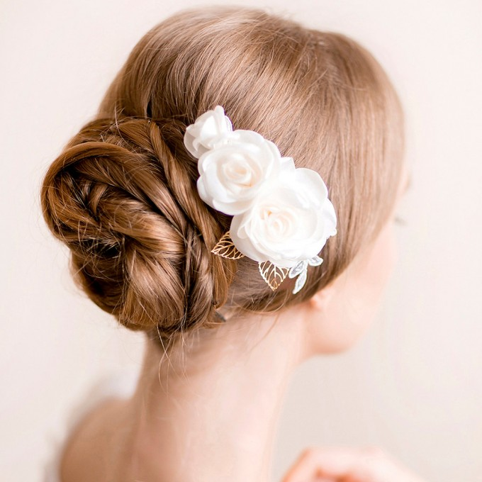 bridal hair bun with hair comb | hairstyles accessories weddings | http://emmalinebride.com/bride/hairstyles-accessories-weddings/ | via florentes: http://etsy.me/22yo1LX