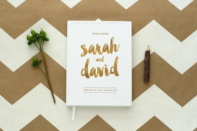 gold and white guest book