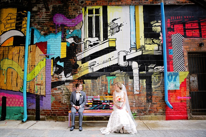 Detroit_wedding_bride_groom_art_graffiti Downtown Detroit Wedding - http://emmalinebride.com/real-weddings/a-beautiful-downtown-detroit-wedding-nick-jeannine/ | Michigan wedding photographer - The Camera Chick