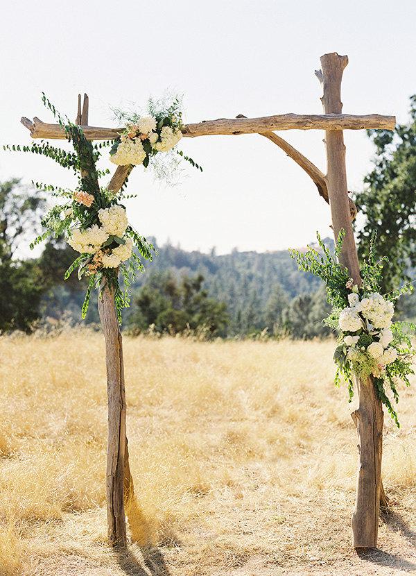 driftwood arch by saltygirlandlongdog | Where to Buy Wedding Arches | https://emmalinebride.com/ceremony/arches-weddings/