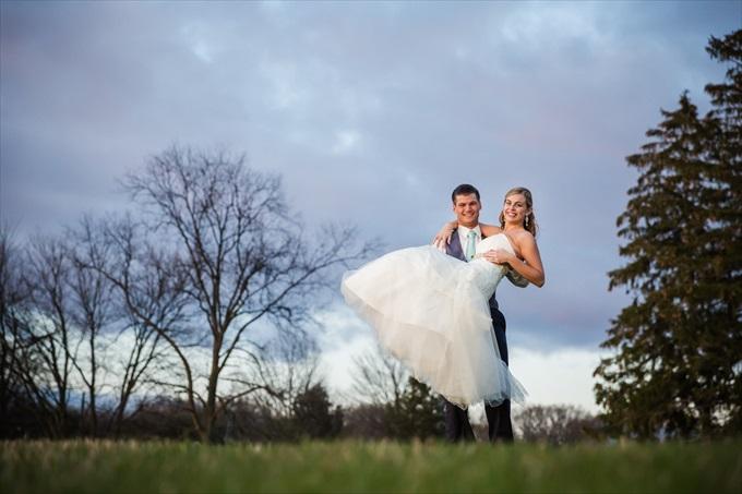 groom_carrying_bride_michigan_wedding