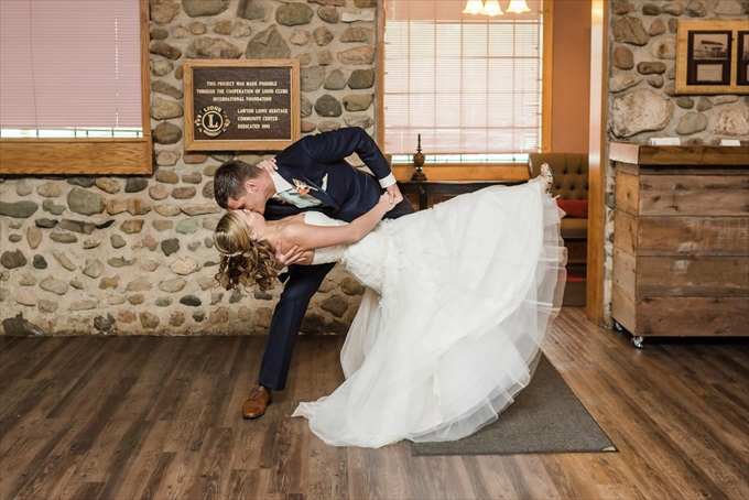 groom_kissing_bride_michigan_wedding