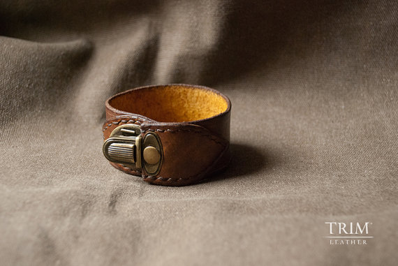 leather cuff bracelet by trimleather | via 40+ Best Leather Groomsmen Gifts for Weddings | https://emmalinebride.com/gifts/leather-groomsmen-gifts/