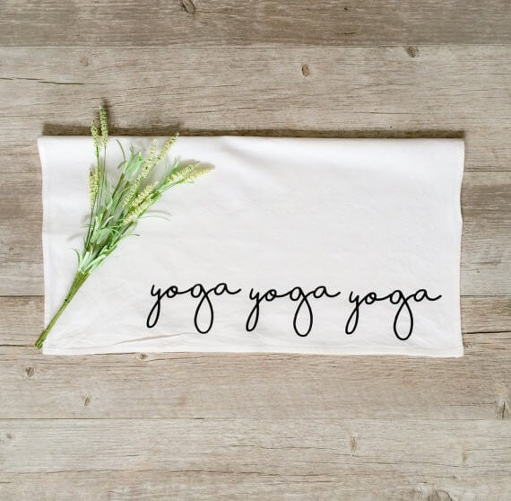 yoga sweat towel | bridesmaid yoga pants, tank tops, gifts & more | https://emmalinebride.com/gifts/bridesmaid-yoga-pants-gifts/