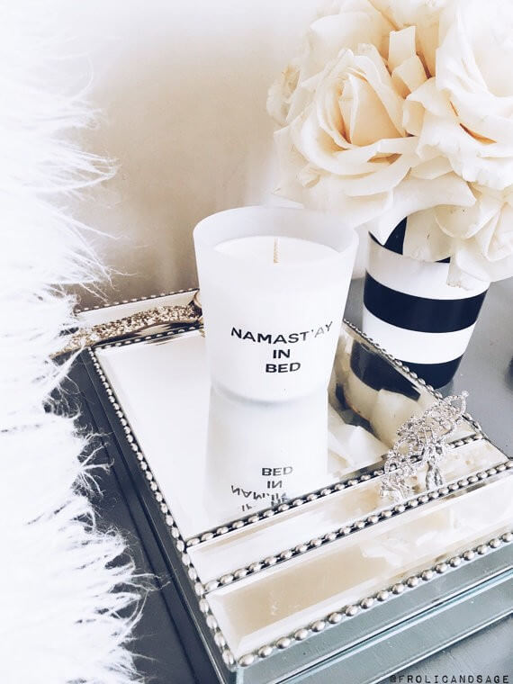 namaste in bed candle | bridesmaid yoga pants, tank tops, gifts & more | https://emmalinebride.com/gifts/bridesmaid-yoga-pants-gifts/
