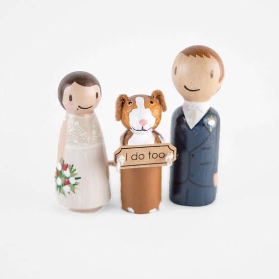 peg doll topper with dog that has sign with i do too | peg doll cake topper