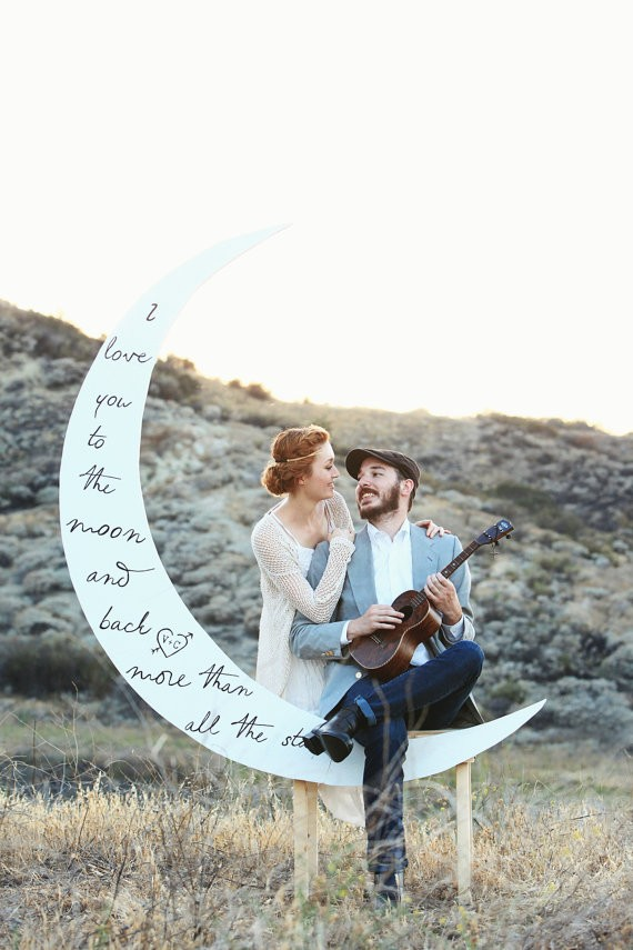 moon backdrop via 26 Things Guests Love at Weddings from A to Z | https://emmalinebride.com/planning/things-guests-love-at-weddings/