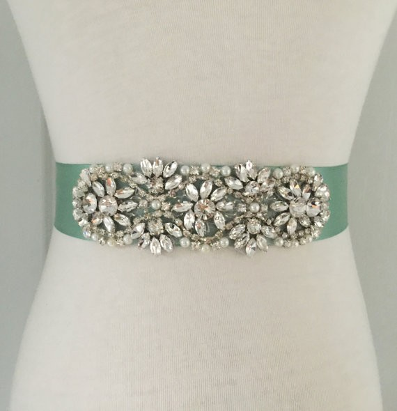 sage bridal sash by roseybloomboutique | via Sage Wedding Ideas from https://emmalinebride.com/color/sage-green-wedding-ideas/