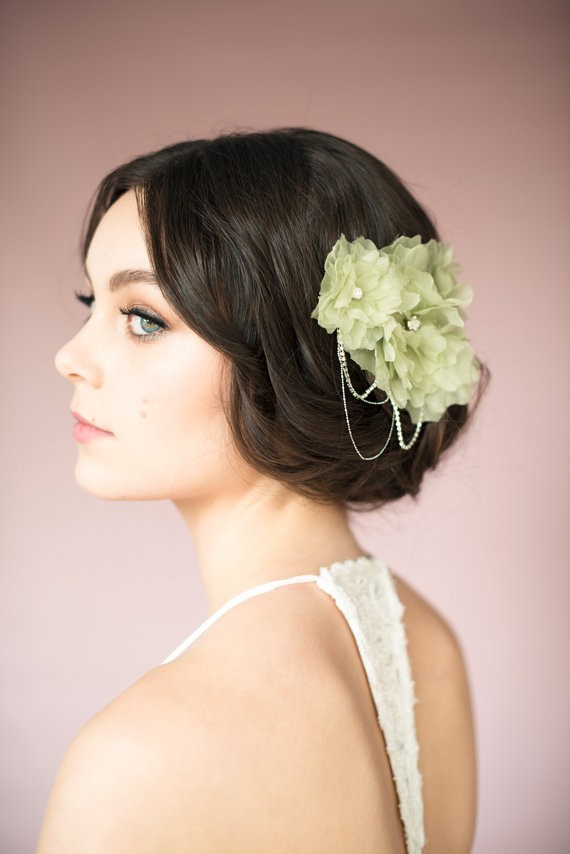 sage green bridal hair accessory | via Sage Wedding Ideas from https://emmalinebride.com/color/sage-green-wedding-ideas/