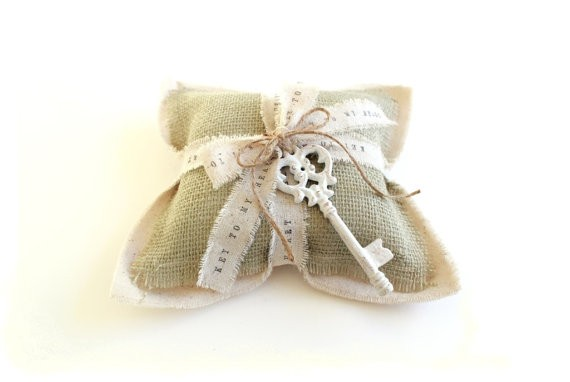 sage wedding ring pillow | via Sage Wedding Ideas from https://emmalinebride.com/color/sage-green-wedding-ideas/