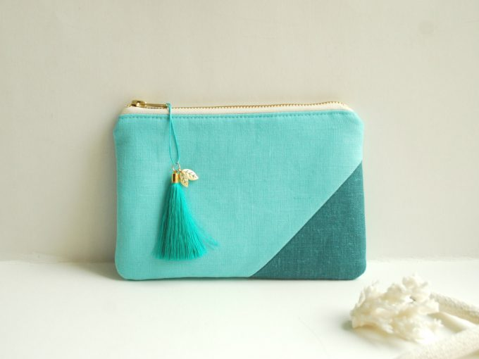 Aqua clutch purse with tassel by Adatele via 21 Festive Tassel Wedding Decorations & Accessories | http://emmalinebride.com/themes/tassel-wedding-decorations/