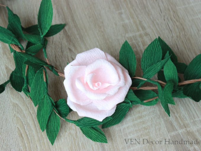 Paper flower garland makes a beautiful decoration for weddings or bridal showers. By Ven Decor.
