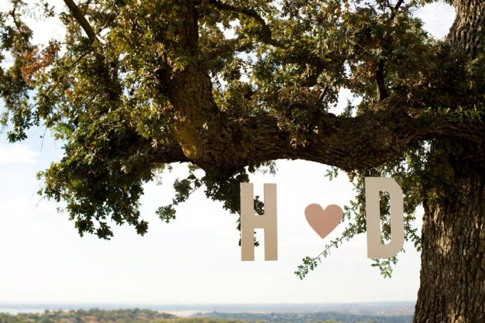 hanging initials decor | via Heart and Arrow Wedding Ideas: https://emmalinebride.com/themes/heart-and-arrow-wedding-ideas