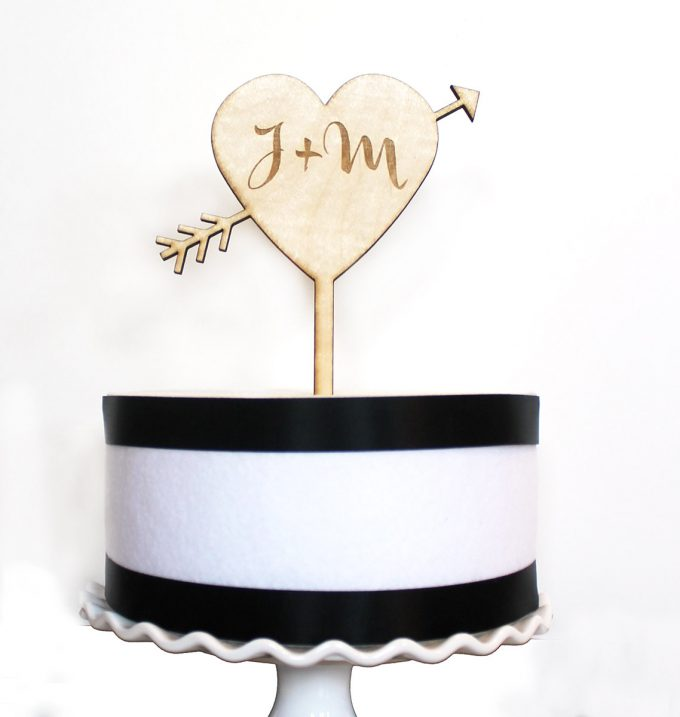 heart and arrow cake topper | via Heart and Arrow Wedding Ideas: https://emmalinebride.com/themes/heart-and-arrow-wedding-ideas