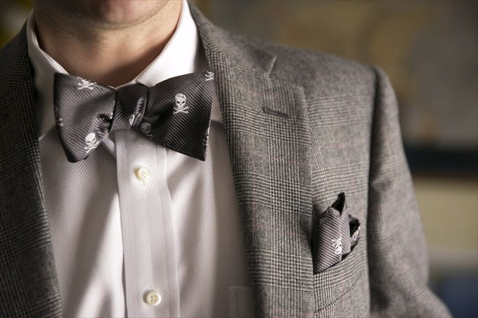 grooms skull and crossbones bow tie in this Crystal Coast Wedding | North Carolina wedding photographed by Ellen LeRoy Photography - https://emmalinebride.com/real-weddings/breathtaking-crystal-coast-wedding-mara-will-married/