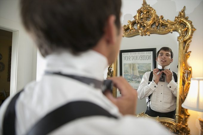 groom getting ready in this Crystal Coast Wedding | North Carolina wedding photographed by Ellen LeRoy Photography - http://emmalinebride.com/real-weddings/breathtaking-crystal-coast-wedding-mara-will-married/
