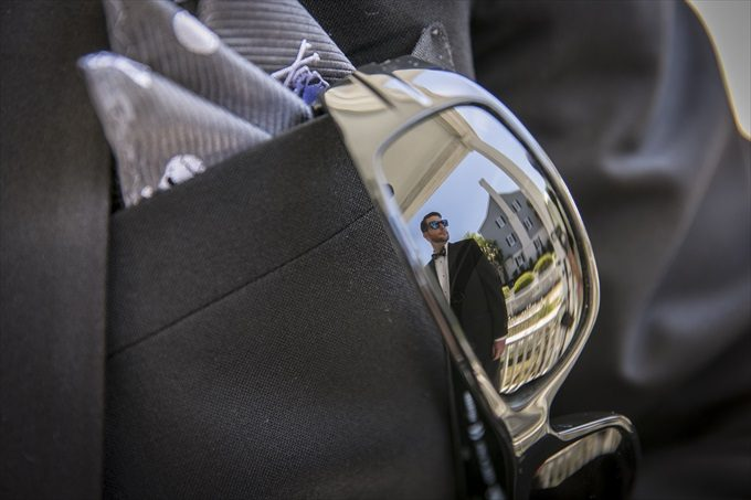 grooms sunglasses reflection in this Crystal Coast Wedding | North Carolina wedding photographed by Ellen LeRoy Photography - http://emmalinebride.com/real-weddings/breathtaking-crystal-coast-wedding-mara-will-married/